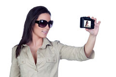 Sexy girl with sunglasses making a picture Stock Images