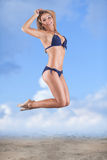 Sexy girl in swimsuit jumping Royalty Free Stock Images