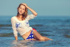 Sexy girl in a swimsuit at the sea. Young sexy girl in a swimsuit at the sea stock photos