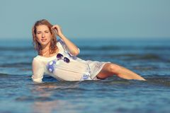 Sexy girl in a swimsuit at the sea. Young sexy girl in a swimsuit at the sea royalty free stock photo