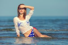 Sexy girl in a swimsuit at the sea. Young sexy girl in a swimsuit at the sea stock photography