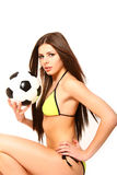 Sexy girl in a swimsuit with a soccer ball on a white background Royalty Free Stock Images