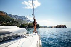 Sexy girl in swimwear on yacht in tropics Stock Image