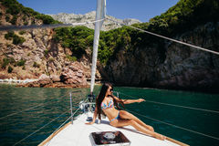 Sexy girl in swimwear on yacht in tropics Royalty Free Stock Photography