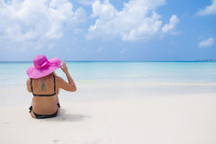 Sexy girl with tattoo in black swimsuit, hat and sunglasses enjo Stock Photo