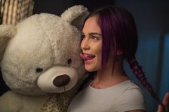 Girl . With a Teddy bear in his hands. Close up royalty free stock photography