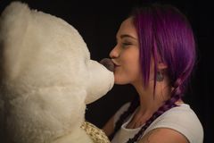 Girl . With a Teddy bear in his hands. Close up stock image