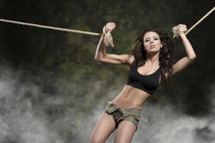 Sexy girl tied by rope on militry background Royalty Free Stock Photos