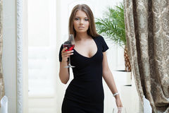 Sexy girl, tight black dress, posing in restaurant Stock Image