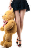 Sexy girl with toy bear Stock Image