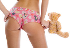 Sexy girl and toy bear Stock Images