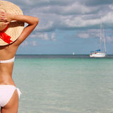 girl on tropical beach. Beautiful young woman with sun hat Royalty Free Stock Image