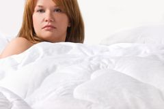 Sexy girl under white blanket Stock Photography