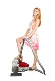 Sexy girl with vacuum cleaner Royalty Free Stock Images