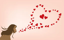 Sexy  girl with Valentine day's heart. Glamour woman and flying hearts Royalty Free Stock Image