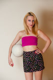 Sexy Girl with Volley Ball. Pretty sexy girl with blond hair posing in pink top with volley ball Stock Image