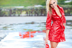 Sexy girl walking along wet street after rain Royalty Free Stock Photography
