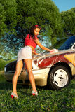 Sexy girl washing a car - pin-up style Royalty Free Stock Photo