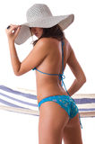 Sexy girl wearing bikini with summer hat. And hammock on the background Royalty Free Stock Photos
