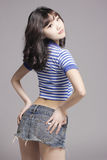 Sexy girl. Wearing Denim miniskirt and a Navy shirt Stock Images