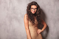 Sexy girl wearing glasses poses smiling and looking at the camer Royalty Free Stock Photo