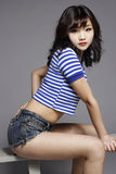Sexy girl. Wearing hot pants and a Navy shirt Stock Photography