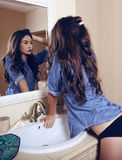 Sexy girl  wearing lingerie and jeans shirt posing in bathroom Royalty Free Stock Photography