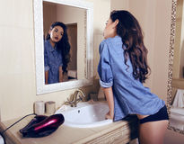 Sexy girl  wearing lingerie and jeans shirt posing in bathroom Stock Images