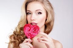 Sexy girl wearing pink dress with candy. Royalty Free Stock Photo