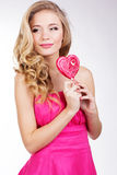 girl wearing pink dress with candy. royalty free stock photo