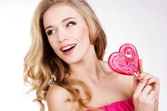 Sexy girl wearing pink dress with candy. Royalty Free Stock Photos