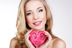 Sexy girl wearing pink dress with candy. Stock Photography