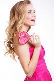 Sexy girl wearing pink dress with candy Royalty Free Stock Photos