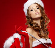 Sexy girl wearing santa claus clothes Royalty Free Stock Image