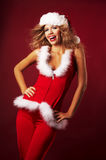 Sexy girl wearing santa claus clothes Stock Images