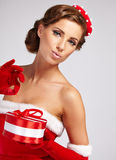 Sexy girl wearing santa claus clothes Royalty Free Stock Photos