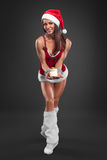 Sexy girl wearing santa claus clothes Royalty Free Stock Photography