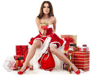 girl wearing santa claus clothes with christmas g royalty free stock image