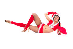 Sexy girl wearing santa claus clothes lies Stock Photos