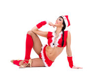 Sexy girl wearing santa claus clothes posing Royalty Free Stock Images