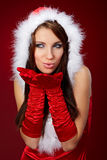 Sexy girl wearing santa claus clothes on r Royalty Free Stock Image