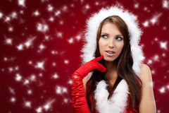 Sexy girl wearing santa claus clothes on r Royalty Free Stock Photos