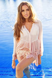 Sexy girl is wearing silk wet shirt in swimming Stock Photos
