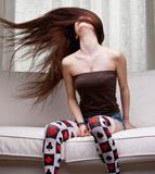 Sexy girl whirling her long hair. Very young girl rotating her hair in the air Royalty Free Stock Photos