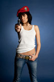 Sexy girl whit a gun an red baret Stock Images