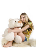 Sexy girl and a white bear Royalty Free Stock Photo