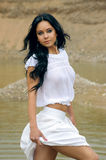 Sexy girl in white walking in river Stock Photo