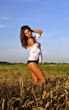 girl in white shirt in field Royalty Free Stock Photography