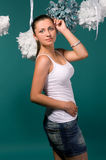 girl in a white T-shirt and denim skirt Royalty Free Stock Photography