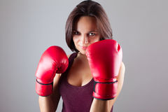 Sexy girl woman athlet in red boxing gloves Stock Photo